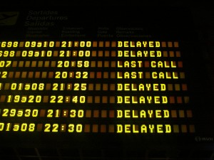 airport sign with delays