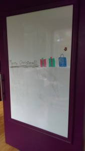 Office door with decorated whiteboard